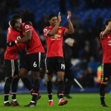England's midfielder Jesse Lingard (L) gestures with Manchester United's French midfielder Paul Pogba (2L) as England's striker Marcus Rashford (2R) and Manchester United's Spanish midfielder Juan Mata applaudafter the English Premier League football match between Everton and Manchester United at Goodison Park in Liverpool, north west England on January 1, 2018. / AFP PHOTO / Paul ELLIS / RESTRICTED TO EDITORIAL USE.No use with unauthorized audio, video, data, fixture lists, club/league logos or 'live' services. Online in-match use limited to 75 images, no video emulation.No use in betting, games or single club/league/player publications. /