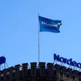 Flaget vejrer over Nordeas hovedkvarter i Helsinki. Torsdag har den nordiske storbank fremlagt regnskabstallene for årets første seks måneder.