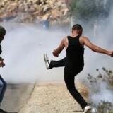 Israelerne og palæstinenserne talte seks døde efter en fredag, der indtil de tidlige eftermiddagstimer forløb forholdsvist planmæssigt og roligt. / AFP PHOTO / ABBAS MOMANI