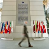 A man walks past a board displaying the words 'European Central Bank' in 24 languages at the European Central Bank (EZB) in Frankfurt/Main, Germany, 20 February 2015. The eurozone economy accelerated further in February, with a key business indicator reaching a seven-month high, despite new fears that Greece's debt crisis could hurt the currency bloc, media reports were citing the London-based Markit research group as saying on 20 February. EPA/CHRISTOPH SCHMIDT