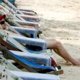 Enlig turist på Pattaya strand.