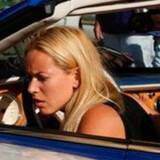 Turister flokkes til sammenstødet af de dyre biler foran Monte Carlo Casino i Monaco. Foto: dailyfun.us