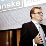 Eivind Kolding fremlægger Danske Banks regnskab for første halvår 2013 - som indeholder mange gode nyheder på trods af nedjusteringen på en milliard kroner.