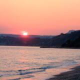 Solnedgang over den græske ø Kefalonia.