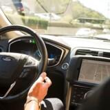 Spørgsmålet om selvkørende biler og sikkerheden ved dem optager sindene verden over, for hvornår tør man slippe rattet og lade bilen køre selv? Og hvad nu, hvis det går galt? Storbritannien går nu i gang med at ændre sin lovgivning. Arkivfoto: Angelo Merendino, AFP/Scanpix