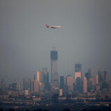 FILE PHOTO: A Virgin Atlantic airplane flies past the haze covered skyline of New York's Lower Manhattan as seen from the Eagle Rock Reservation in West Orange, New Jersey, August 31, 2012. REUTERS/Gary Hershorn/File Photo