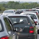 ARKIVFOTO: Der vil komme længere køer i myldretiden på de strækninger, hvor elektroniske trafiktavler bliver fjernet.