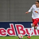 Yussuf Poulsen og RB Leipzig kan med et point ude mod Bayer Leverkusen sætte sig på førstepladsen i Bundesligaen. (Arkivfoto). Scanpix/Jan Woitas