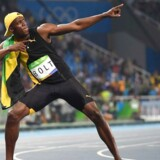 Jamaica's Usain Bolt does his 'Lightening Bolt' pose as he celebrates winning the Men's 100m Final during the athletics event at the Rio 2016 Olympic Games at the Olympic Stadium in Rio de Janeiro on August 14, 2016. / AFP PHOTO / OLIVIER MORIN