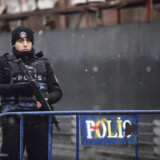 TOPSHOT - A Turkish police officer stands guard close to the site of an armed attack near the Reina night club, one of the Istanbul's most exclusive party spots, early on January 1, 2017 after at least one gunmen went on a shooting rampage during New Year's Eve celebrations. Thirty-nine people, including many foreigners, were killed when a gunman reportedly dressed as Santa Claus stormed an Istanbul nightclub as revellers were celebrating the New Year, the latest carnage to rock Turkey after a bloody 2016. / AFP PHOTO / YASIN AKGUL