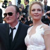 Quentin Tarantino med Uma Thurman, som startede den kritiske bølge mod Tarantino, men senere har trukket i land. Mere opsigt har et 15 år gammelt radio-interview vakt - hvor Tarantino forsvarer Roma Polanski mod voldtægts-anklagen.