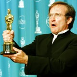 "Actor Robin Williams holds the Oscar he won for Best Supporting Actor for his role in ""Good Will Hunting"" during the 70th Annual Academy Awards 23 March in Los Angeles, CA. AFP PHOTO Hal GARB"