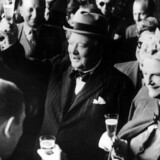 26th August 1946: Former British prime minister Winston Leonard Spencer Churchill (1874 - 1965) and his wife Clementine make a toast upon their arrival in Switzerland. (Photo by Keystone/Getty Images)