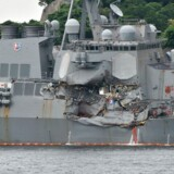 This photo shows damages on the guided missile destroyer USS Fitzgerald at its mother port in Yokosuka, southwest of Tokyo on June 18, 2017. A number of missing American sailors have been found dead in flooded areas of a destroyer that collided with a container ship off Japan's coast, the US Navy said on June 18, 2017. / AFP PHOTO / Kazuhiro NOGI
