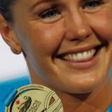 Jeanette Ottesen svømmede sig øverst på sejrspodiet i Windsor. Scanpix/Gregory Shamus