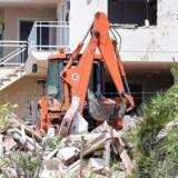 Murbrokkerne af det hus, hvor en terrorcelle formodes at have arbejdet på at lave bomber, inden de stod bag et dobbelt angreb i Barcelona og Cambrils i Spanien.