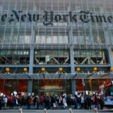 """People take part in a protest outside the New York Times on February 26, 2017 in New York. The White House denied access Frebuary 24. 2017 to an off-camera briefing to several major US media outlets, including CNN and The New York Times. Smaller outlets that have provided favorable coverage however were allowed to attend the briefing by spokesman Sean Spicer. The WHCA said it was """"protesting strongly"""" against the decision to selectively deny media access. The New York Times said the decision was """"an unmistakable insult to democratic ideals, """" CNN called it """"an unacceptable development, """" and The Los Angeles Times warned the incident had """"ratcheted up the White House's war on the free press"""" to a new level. / AFP PHOTO / KENA BETANCUR"""