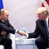 USAs præsident mødes med sin russiske kollega. / AFP PHOTO / SAUL LOEB