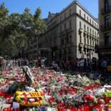 Blomster på Ramblaen i Barcelona efter angrebet 17 august 20117 / AFP PHOTO / LLUIS GENE