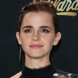 Her ses Emma Watson, efter at hun har modtaget sin pris. Scanpix/Jean-baptiste Lacroix