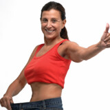 Foto: Graphic Design Resources/Bigstock Happy mature woman in old jeans pant after losing weight