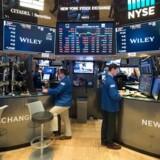 De tre store amerikanske aktieindeks endte onsdag med kursfald efter en volatil handelssession.. / AFP PHOTO / Bryan R. Smith