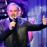 (FILES) This file photo taken on February 11, 2017 shows singer Neil Diamond performing during the annual Clive Davis pre-Grammy gala at the Beverly Hilton Hotel. Diamond announced on his website on January 22, 2018, he has been diagnosed with Parkinson's disease. He also announced his retirement. / AFP PHOTO / Frederic J. BROWN