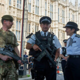 Metropolitan Police Commissioner Cressida Dick (R) meets soldiers and police officers on deployment in the Palace of Westminster, in central London, on May 24, 2017 after Operation Temperer was put in place deploying soldiers to help secure key sites in Britain. Britain deployed soldiers to key sites Wednesday and raised its terror alert to the maximum after the Manchester suicide bombing by Salman Abedi, reportedly a Briton of Libyan descent, who may have been radicalised in Syria. Prime Minister Theresa May announced that the army would be deployed on the streets to support armed police under a plan codenamed Operation Temperer, which was developed in the aftermath of the November 2015 Paris terror attacks. / AFP PHOTO / POOL / Victoria Jones