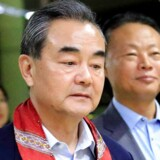 People's Republic of China Foreign Minister Wang Yi gestures as he is escorted by Zhao Jianhua, Chinese ambassador to the Philippines, upon arrival at the international airport of Pasay to attend the 50th ASEAN Foreign Ministers meeting, metro Manila, Philippines August 5, 2017. REUTERS/Romeo Ranoco