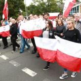 Her demonstrerer de lokale i Harlow, Storbritannien, 3. september, for at mindes polakken Arkadiusz Jozwik, der blev myrdet i byen 27 august.