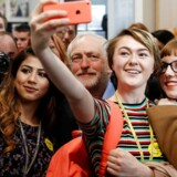 FILE PHOTO: Jeremy Corbyn, the leader of Britain's opposition Labour Party, poses for selfies at a campaign event in Leeds, May 10, 2017. REUTERS/Phil Noble/File Photo