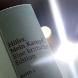 "A copy of an annotated version of Adolf Hitler's book ""Mein Kampf"" is pictured prior to a press conference for it's presentation in Munich, southern Germany, on January 8, 2016. New copies of Hitler's ""Mein Kampf"" hit bookstores in Germany for the first time since World War II, unsettling some Jewish community leaders as the copyright of the anti-Semitic manifesto expires. The southern German state of Bavaria was handed the copyright of the book in 1945, when the Allies gave it control of the main Nazi publishing house following Hitler's defeat. For 70 years, it refused to allow the inflammatory tract to be republished out of respect for victims of the Nazis and to prevent incitement of hatred. / AFP / Christof STACHE"
