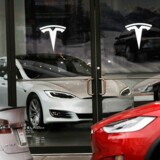 NEW YORK, NY - APRIL 04: A Tesla car is displayed in a showroom at a Brooklyn Tesla dealership on April 4, 2017 in New York City. As of Monday, the start-up car maker founded by Elon Musk had passed iconic car manufacture Ford in market value, riding a 7 percent share-value surge to a market capitalization of about $48.7 billion. Spencer Platt/Getty Images/AFP == FOR NEWSPAPERS, INTERNET, TELCOS & TELEVISION USE ONLY ==