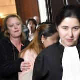 En af tjenestefolkende, der blev udsat for en horribel behandling af de otte prinsesser, møder i retten i Bruxelles. Ingen af de otte anklagede var mødt op.