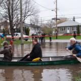 Miljøministeren i provinsen Quebec, David Heurtel, beskriver voldsomt regnvejr siden fredag - og de følgende oversvømmelser - som historiske. Scanpix/Catherine Legault