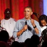Barack Obama fejrer USAs uafhængighedsdag i Det Hvide Hus med sangerinden Janelle Monae (th) og rapper Kendrick Lamar (tv.).
