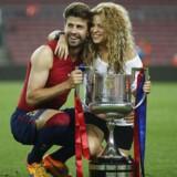 Gerard Piqué - her fotograferet sammen med sin kone, den colombianske popstjerne Shakira, efter en sportslig triumf, holder sig ikke tilbage med at udtale sig om politik. Dagens catalanske regionalvalg er ingen undtagelse. EPA/Andreu Dalmau