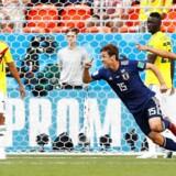 Colombia måtte spille med ti mand efter blot tre minutter af kampen og tabte 1-2 til Japan.