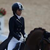 Chung Yoo-ra blev anholdt i Aalborg-forstaden Gug 1. januar i år efter tip fra en sydkoreansk journalist. Kvinden er internationalt efterlyst for medvirken til omfattende økonomisk kriminalitet i sit hjemland. Chung Yoo-ra er et kendt navn i hestesportskredse og har blandt andet vundet guld ved Asian Games. Reuters/Kim Hong-ji