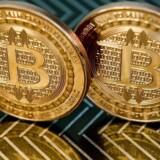 Bitcoin er en digital valuta, som på syv år er blevet stor, men det er endnu ikke helt klart, hvem der står bag. Arkivfoto: Karen Bleier, AFP/Scanpix