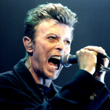 FILE PHOTO: British Pop Star David Bowie screams into the microphone as he performs on stage during his concert in Vienna February 4, 1996. REUTERS/Leonhard Foeger/File Photo