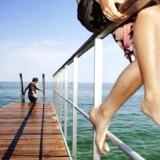 Sol, sommer og badning på Bellevue Strand nord for København, der er en af de få danske strande, der i 2010 ikke fik det blå flag.