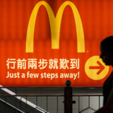 A woman walks past a McDonald's outlet in Hong Kong in this July 25, 2014 file photo. REUTERS/Tyrone Siu/Files Photo