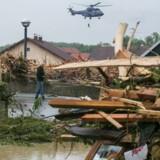 Byen Simbach am Inn i den tyske delstat Bayern er hårdt ramt af oversvømmelser. Scanpix/Daniel Scharinger