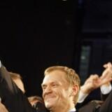 Donald Tusk fra Borgerplatformen viser her de første tegn på sejr.