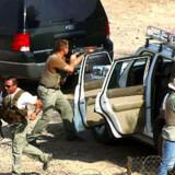 Udenlandske sikkerhedsstyrker i aktion i Bagdad.