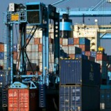 A straddle carrier moves discharged cargo at APM Terminals Rotterdam Holland