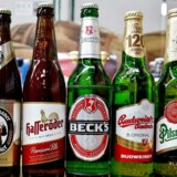 epa04976386 Beer bottles branded Corona (L-R), Diebels, Loewenbraeu, Franziskaner, Hasseroeder, Beck's and Budweiser owned by beverage and brewing company Anheuser-Busch InBev (AB InBev) have been placed next to Pilsner Urquell and Tyskie bottles owned by SABMiller, in Nuremberg, Germany, 13 October 2015. AB InBev and SABMiller, the world's largest and second-largest brewing corporation respectively, have closed in on a multi-billion-euro takeover agreement. EPA/DANIEL KARMANN