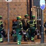 """Medics deploy at the scene of a reported explosion during a concert in Manchester, England on May 23, 2017. British police said early May 23 there were """"a number of confirmed fatalities"""" after reports of at least one explosion during a pop concert by US singer Ariana Grande. Ambulances were seen rushing to the Manchester Arena venue and police added in a statement that people should avoid the area / AFP PHOTO / Paul ELLIS"""