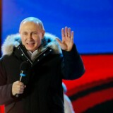 epa06613469 Russia's President Vladimir Putin delivers a speech during a rally in his support near Kremlin in Moscow, Russia, 18 March 2018. Russians are electing the President of Russia in the 18 March elections, with eight candidates contesting for the presidential seat, including the incumbent president Vladimir Putin, who leads with over 72 per cent of the vote and projected to win his fourth term in the Kremlin. EPA/YURI KOCHETKOV